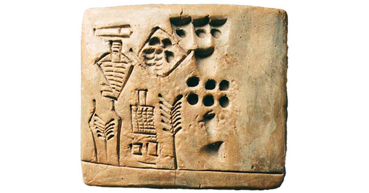 Jedno zdjęcie obrazujące historię copywritingu - przedstawia glinianą tabliczkę opartą na piśmie klinowym.